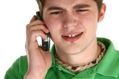 Adolescente atractivo con el teléfono celular Imagenes de archivo