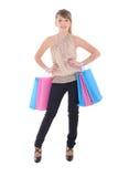 Adolescente atractivo con los bolsos de compras Foto de archivo libre de regalías