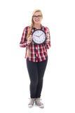 Adolescente atractivo en lentes con el reloj aislado en whi Imagenes de archivo