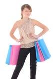 Adolescente atractivo que presenta con los bolsos de compras Fotografía de archivo libre de regalías