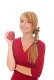 Adolescente atractivo que sostiene la manzana roja disponible Fotos de archivo libres de regalías