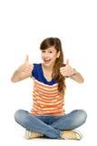 Adolescente avec des pouces vers le haut Photos stock