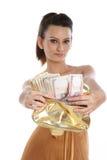 Adolescente avec la bourse pleine de l'argent comptant Photographie stock