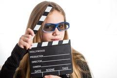 Adolescente avec la claquette Photos libres de droits
