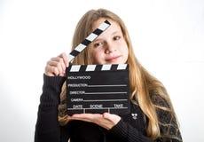 Adolescente avec la claquette Photographie stock