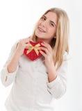Adolescente avec le cadre en forme de coeur Photographie stock libre de droits
