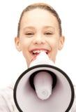 Adolescente avec le mégaphone Photographie stock
