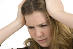 Adolescente avec un mal de tête Image stock