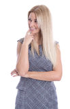 Adolescente bastante rubio aislado en el blanco que mira de lado. Fotos de archivo