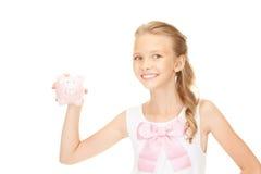 Adolescente bello con la banca piggy Fotografie Stock