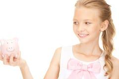 Adolescente bello con la banca piggy Fotografia Stock Libera da Diritti