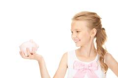 Adolescente bello con la banca piggy Immagini Stock