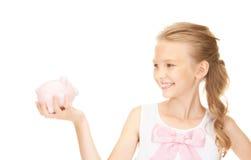 Adolescente bello con la banca piggy Immagine Stock Libera da Diritti