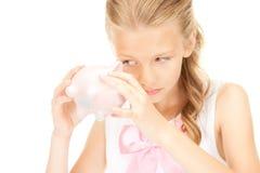 Adolescente bello con la banca piggy Fotografia Stock