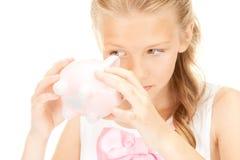 Adolescente bello con la banca piggy Fotografie Stock Libere da Diritti