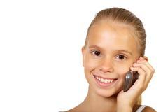 Adolescente bonito con el teléfono móvil Imagenes de archivo