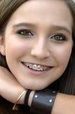 Adolescente bonito con los apoyos Fotografía de archivo