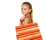 Adolescente bonito con los bolsos de compras Fotografía de archivo