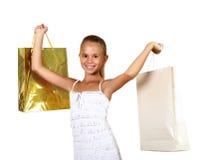 Adolescente bonito con los bolsos de compras Foto de archivo
