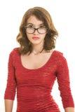 Adolescente bonito con los vidrios en rojo en blanco Imagen de archivo