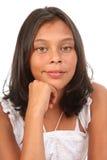 Adolescente bonito en barbilla relaxed de la actitud en la mano Imagenes de archivo