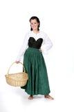 Adolescente bonito en cesta de la explotación agrícola de la alineada de período Fotografía de archivo libre de regalías