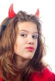 Adolescente bonito en traje de los diablos Imagenes de archivo