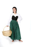 Adolescente bonito na cesta da terra arrendada do vestido de período Fotografia de Stock Royalty Free