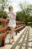 Adolescente bonito no vestido floral Fotografia de Stock Royalty Free