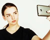Adolescente bonito novo que faz o selfie isolado no backgr branco Imagem de Stock