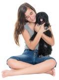Adolescente bonito que abraza su perro casero Fotografía de archivo libre de regalías