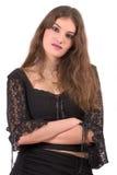 Adolescente bonito que se coloca con los brazos plegables Foto de archivo libre de regalías