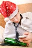 Adolescente borracho en Santa Hat Foto de archivo
