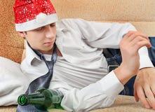 Adolescente borracho en Santa Hat Fotos de archivo libres de regalías