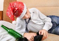 Adolescente borracho en Santa Hat Fotografía de archivo