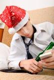Adolescente borracho en Santa Hat Imagen de archivo libre de regalías