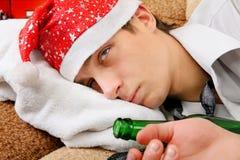 Adolescente borracho en Santa Hat Foto de archivo libre de regalías