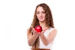 Adolescente brillante con la manzana a disposición Fotografía de archivo libre de regalías