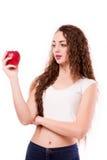 Adolescente brillante con la manzana a disposición Imagen de archivo