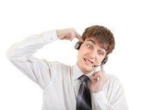 Adolescente cansado con las auriculares Foto de archivo libre de regalías