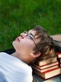 Adolescente cansado con libros Fotografía de archivo