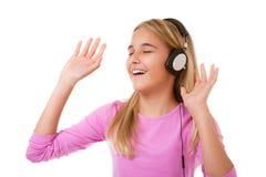 Adolescente cantante con los auriculares Imágenes de archivo libres de regalías