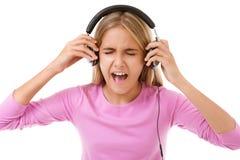 Adolescente cantante feliz con los auriculares aislados Imagen de archivo libre de regalías