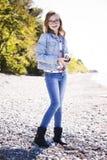 Adolescente casual en la playa Imagen de archivo libre de regalías
