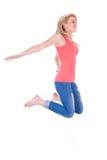Adolescente caucásico feliz joven que salta - gente caucásica Imagen de archivo libre de regalías