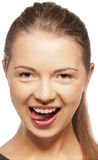 Adolescente che attacca fuori la sua lingua Immagine Stock