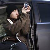 Adolescente che cattura una maschera. Fotografia Stock Libera da Diritti