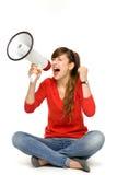 Adolescente che grida tramite il megafono Fotografia Stock