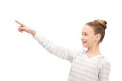 Adolescente che indica la sua barretta Fotografia Stock