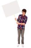 Adolescente che tiene manifesto in bianco Fotografia Stock Libera da Diritti